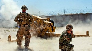 A U.S. Army soldier (left) from Battery B, 5th Battalion, 25th Field Artillery Regiment, 4th Brigade Combat Team, 10th Mountain Division, observes the firing of a D-30 122 mm howitzer by Afghan National Army soldiers from 4th Kandak, 3rd Brigade, 201st Corps, during certification exercises at Forward Operating Base Tagab, Kapisa province, Afghanistan, Sept. 5, 2013. Battery B, stationed in FOB Gamberi in Laghman province, goes throughout eastern Afghanistan advising and instructing artillery soldiers on the proper handling of D-30s, a Soviet-made heavy artillery weapon capable of engaging targets more than 15 kilometers away. (U.S. Army National Guard photo by Sgt. Margaret Taylor, 129th Mobile Public Affairs Detachment/RELEASED)