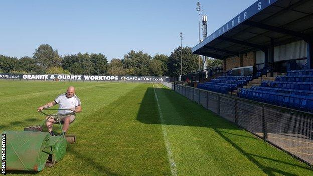 John Thornton cuts the pitch at Farsley Celtic