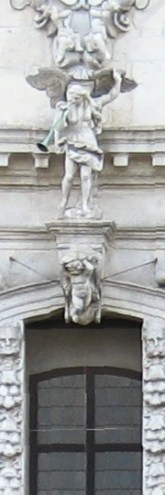 High over the entrance to a church in Venice, the angel Gabriel (I think) blows his horn.