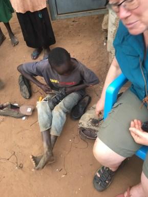 Boy fixing mom's shoe