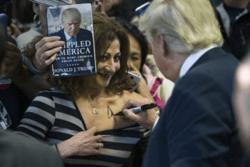 Trump sign woman's chest