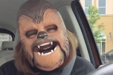 woman laughing chewbacca mask