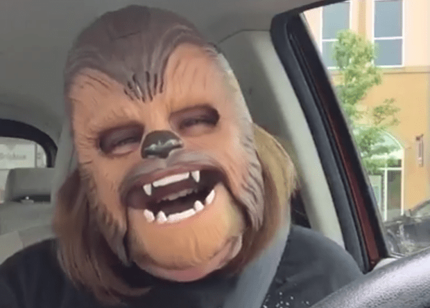 woman laughing chewbacca mask