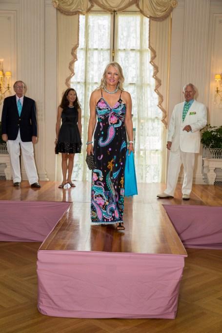 Susan Noel wearing a Kokomo dress escorted by Gary Moore.