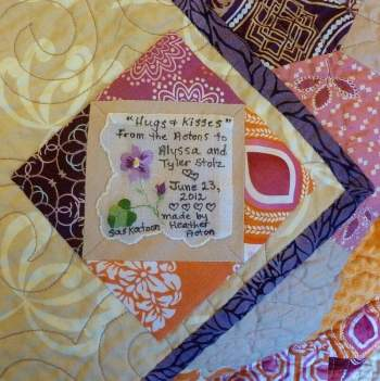 Photo of quilt label with vintage handkerchief
