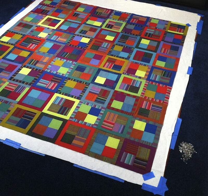 Quilt basted on floor