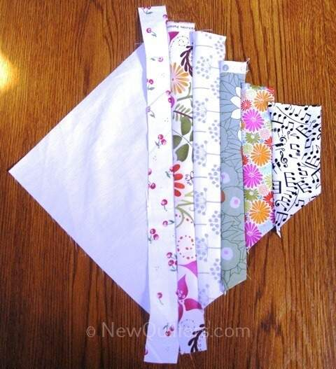 Photo of string quilt block with half the fabric strips added