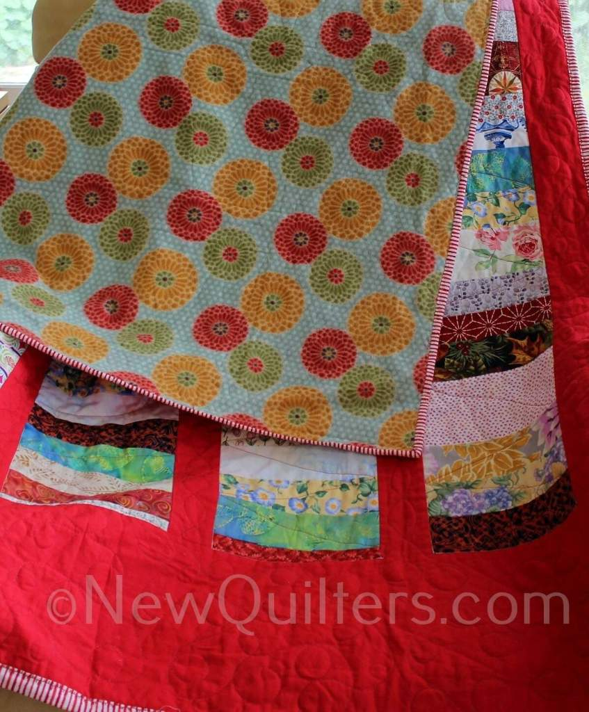 Photo of chinese coins quilt with polar fleece backing