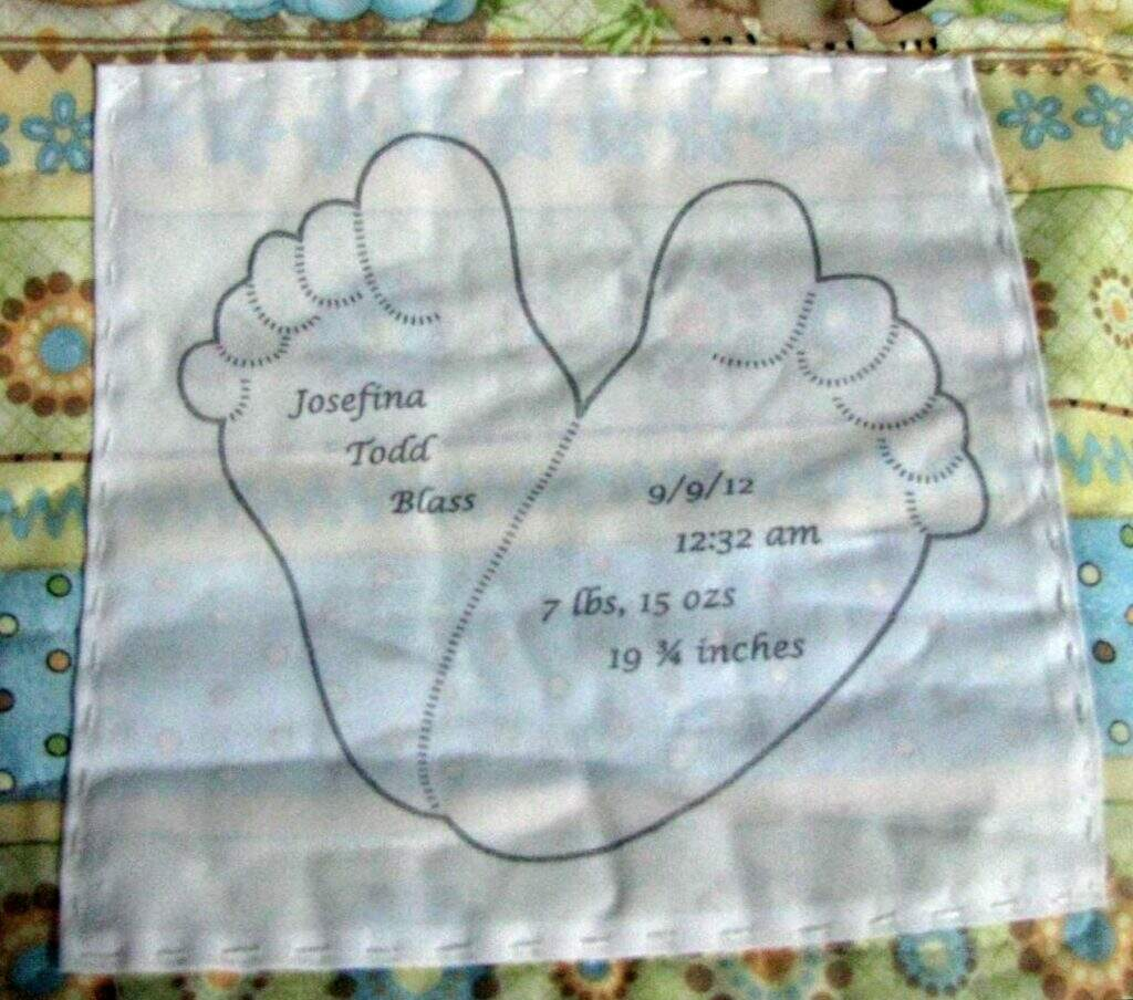 Photo of quilt label with baby feet drawing