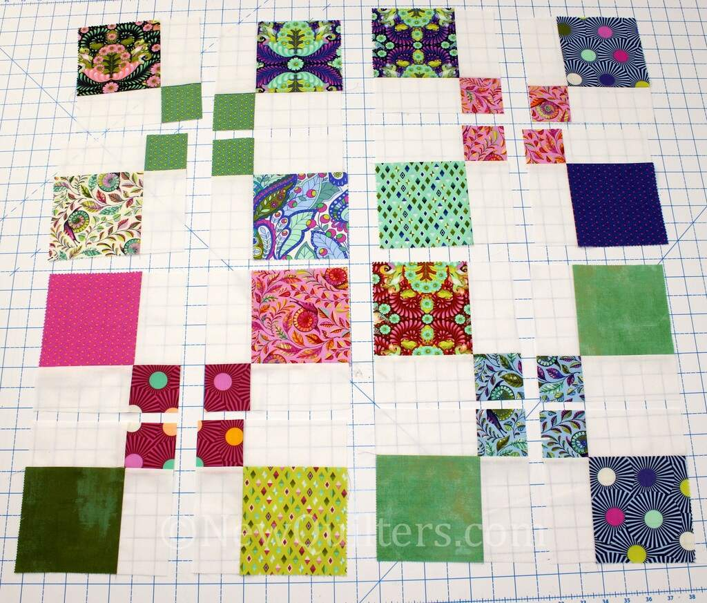 Photo showing how to cut disappearing 9-patch blocks into smaller blocks