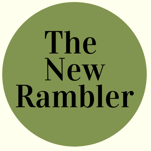 Green circle with The New Rambler written it