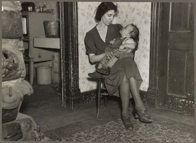 Depression era woman holding a toddler in her lap