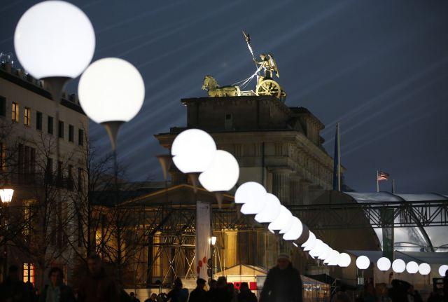 Installation Border of Light along former Berlin Wall location is illuminated next to Brandenburg Gate in Berlin