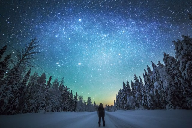 Person looking at starry winter sky, Finland