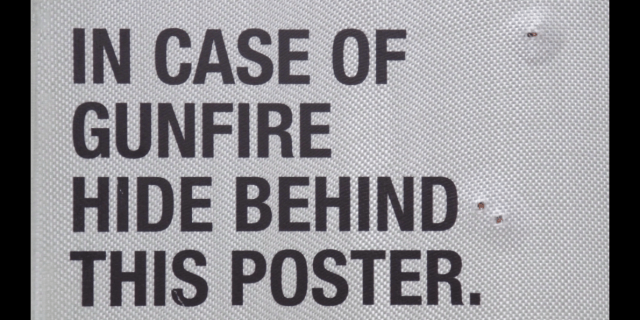 provocative-ad-uses-bulletproof-posters-to-challenge-gun-control-law