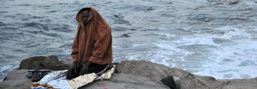 A migrant prays by the sea in Ventimiglia, at the Italian-French border, Tuesday, June 16, 2015. Police at Italy's Mediterranean border with France forcibly removed a few dozen African migrants who have been camping out for days in hopes of continuing their journeys farther north, a violent scene Italy is using to show that Europe needs to do something about the migrant crisis. (Luca Zennaro/ANSA via AP)
