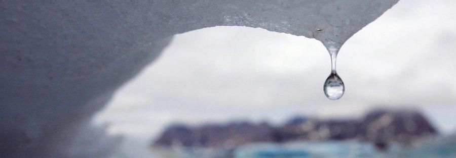 An iceberg melts in Kulusuk Bay, eastern Greenland. (AP Photo/John McConnico)