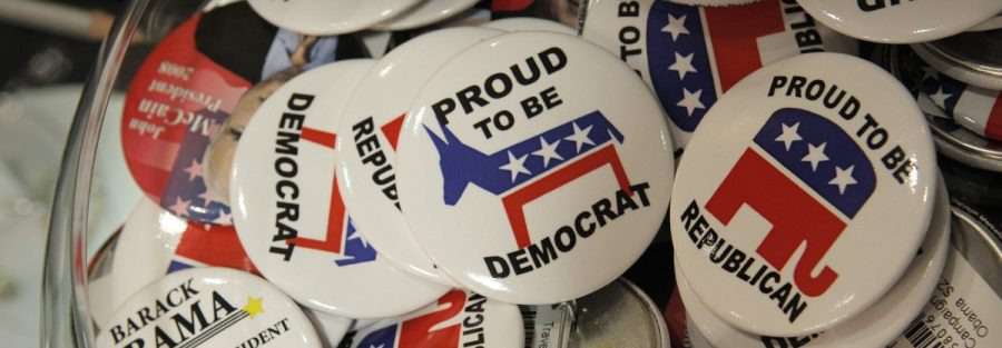 Campaign buttons for Democratic presidential candidate Barack Obama and Republican presidential candidate Sen. John McCain, July 29, 2008. (AP Photo/Jae C. Hong)