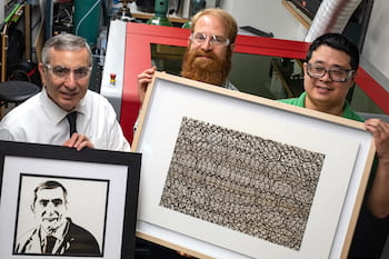 """Imaging with laser-induced graphene (LIG) was taken to a new level in a Rice University lab. From left, chemist James Tour, holding a portrait of himself in LIG; artist Joseph Cohen, holding his work """"Where Do I Stand?""""; and Yieu Chyan, a Rice graduate student and lead author of a new paper detailing the process used to create the art. (Credit: Jeff Fitlow/Rice University)"""