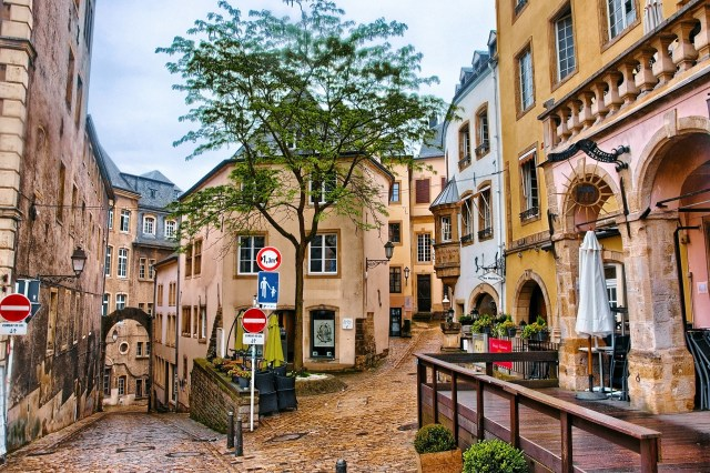 Narrow medieval street with cafes in Luxembourg city, Luxembourg.
