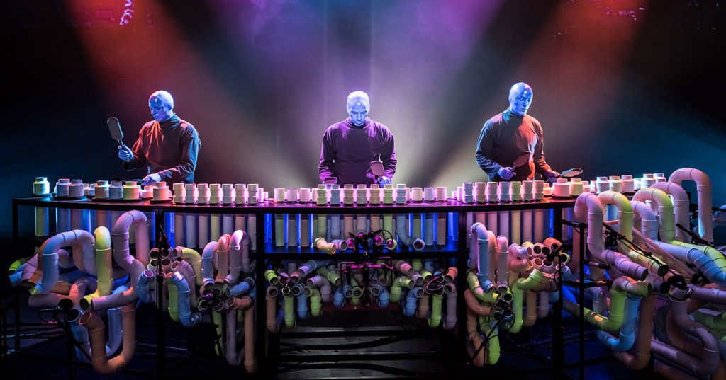The Blue Man Group playing their PVC pipe instrument. Photo by Lindsey Best.