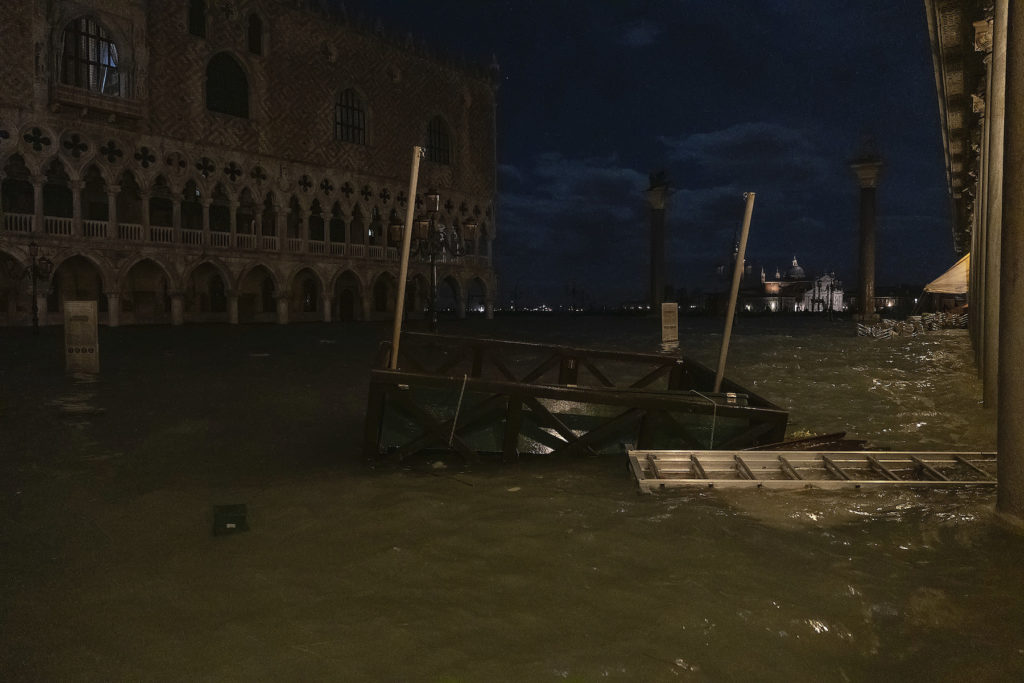 A jetty of gondoliers floats in Piazza San Marco during the floods on November 12, 2019 in Venice. Photo by Stefano Mazzola/Awakening/Getty Images.