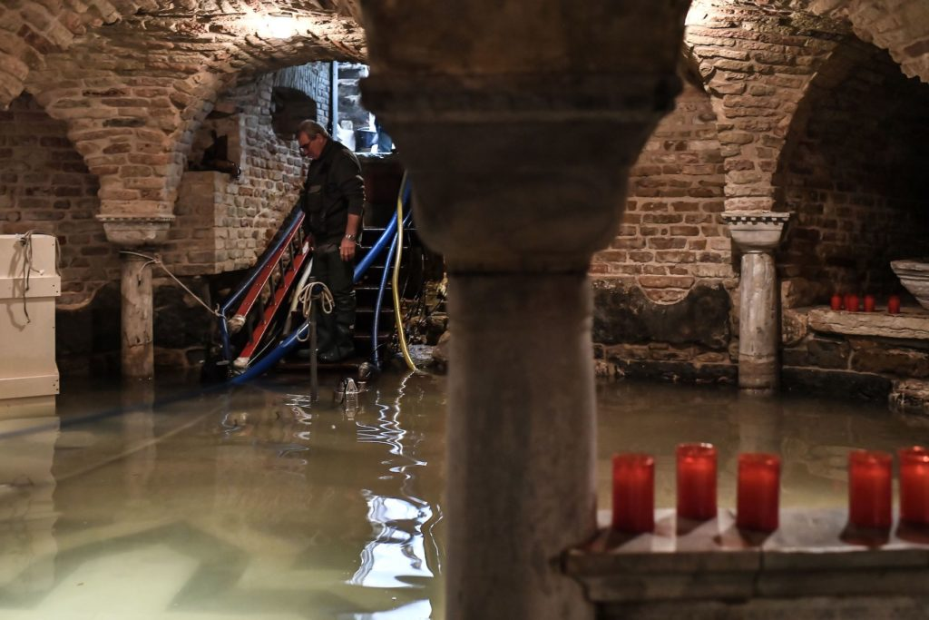A man pumps out water from the flooded crypt of St. Mark's Basilica after the floods on November 12. Photo by Marco Bertorello/AFP via Getty Images.