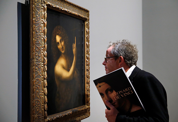 A visitor looks at Saint Jean Baptiste by Leonardo da Vinci on view at the Louvre through February 24th, 2020. Photo by Chesnot/Getty Images.
