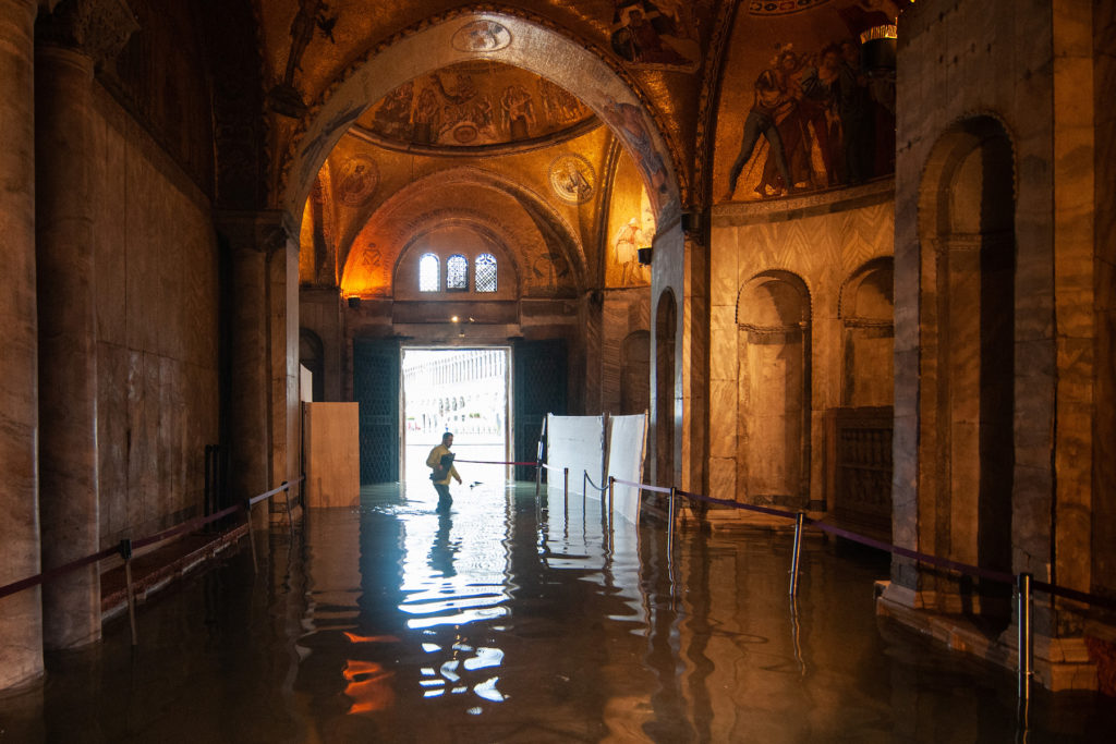 A view inside the flooded St. Mark's Basilica during the floods on November 13 in Venice. Photo by Simone Padovani/Awakening/Getty Images.