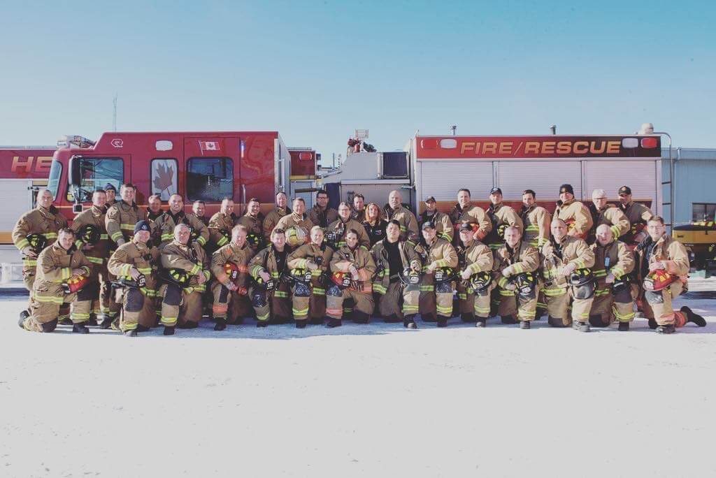City of Geulph firefighters in front of a firetruck