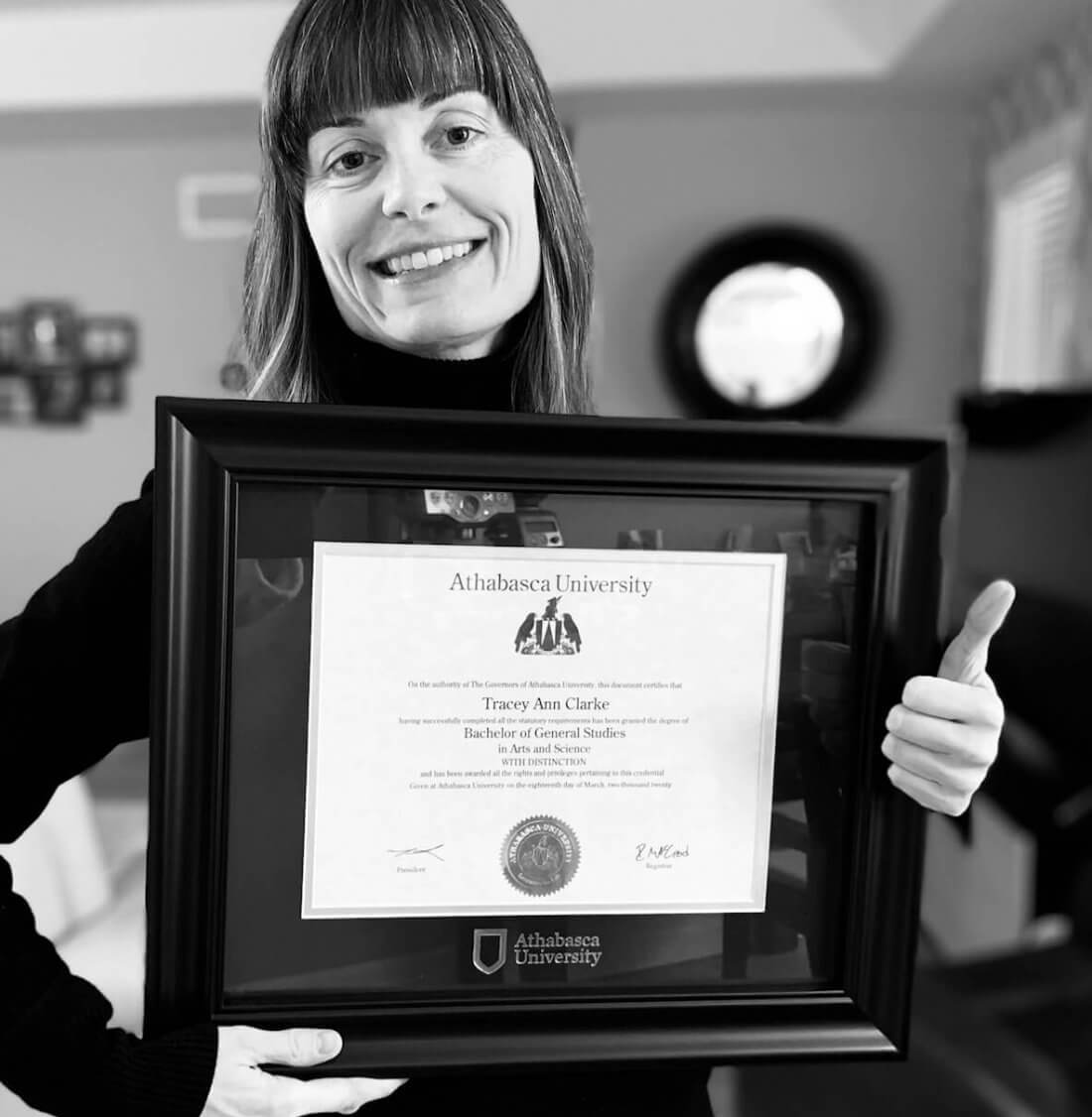 Tracey Clarke holding her Bachelor of General Studies degree from Athabasca University