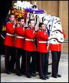 The Queen Mother's coffin is carried out of Westminster Hall