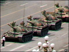 An unidentified man attempts to block tanks entering the square