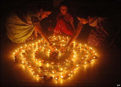 The Hindu festival of lights - called Diwali - started on Saturday. It's being celebrated around the world by Jains and Sikhs as well as Hindus. Here, children in India light candles