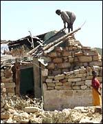 Ethiopian returnee building a home