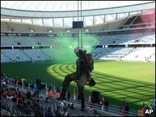 A member of the Police Tactical Response Unit abseils in the Green Point Soccer Stadium, as he take part in a simulated exercise in the Soccer World Cup host city of Cape Town, South Africa, Thursday, April 29, 2010.