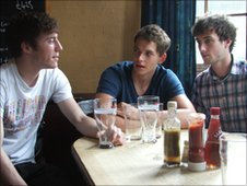 Oli, Stew and Richard chatting in a pub