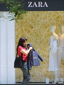 Woman leaving Zara shop in Madrid