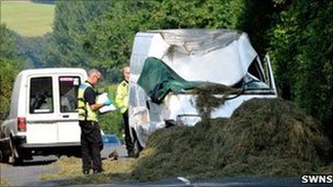 Police inspect the crash scene