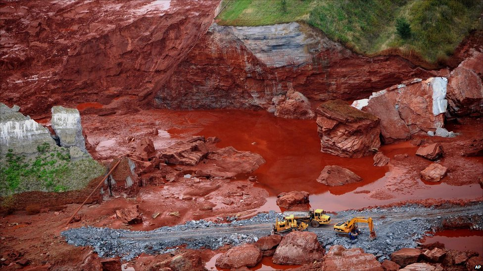 An aerial view of excavators working at a broken dyke of a reservoir that contained red mud of an alumina factory near Ajka