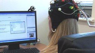 Person wearing an EEG cap