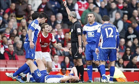 Jack Wilshere is dismissed for a challenge on Nikola Zigic
