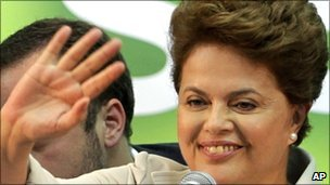 Ms Rousseff waves to supporters during a press conference in Brasilia