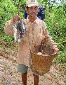 A farmer hunting rats