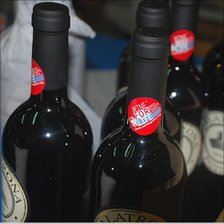 Bottles with 'wine for life' stickers on, Italy, 2010