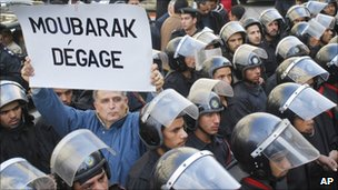 "Protester holds sign saying ""Mubarak, out"" in French during a protest in central Cairo on Tuesday 25 January 2011"