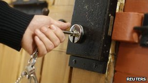 A prison officer locks a cell (generic image)