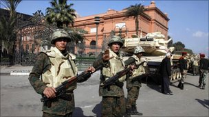 Egyptian troops guard Egyptian museum on Tahrir Square - 12 February photo