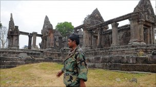 A Cambodian soldier walks past the Preah Vihear temple