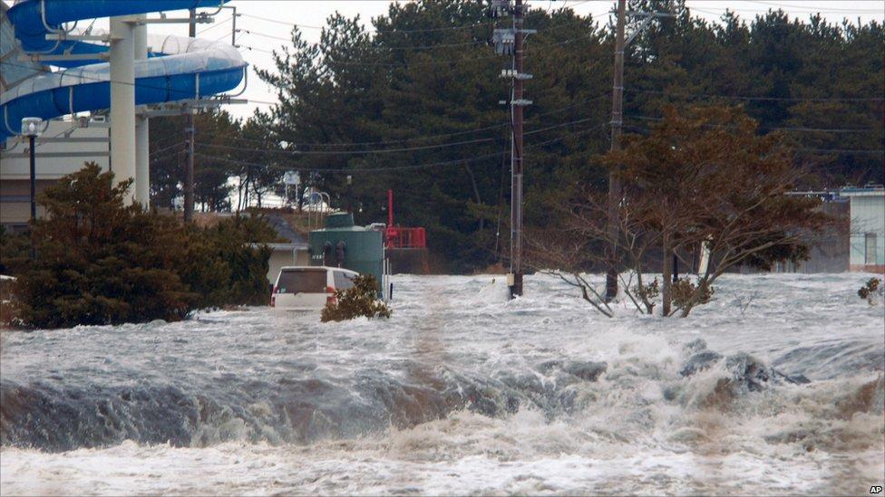 Tsunami flooding in Iwaki, Fukushima prefecture, on 11 March 2011